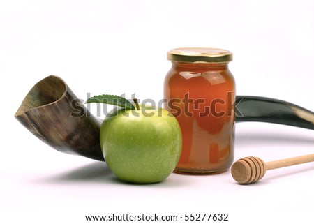 Apple and honey - a snack eaten by jews in Rosh Hashana. Shofar - A horn used in the jewish holidays of Rosh Hashana and Yom Kippur. - stock photo