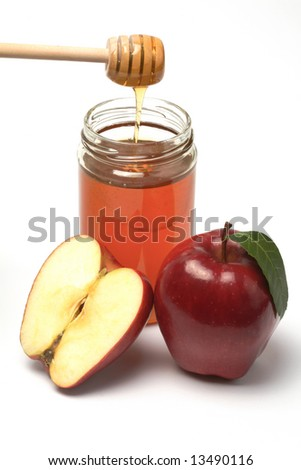 Apple and honey, A snack for the jewish new year, isolated - stock photo