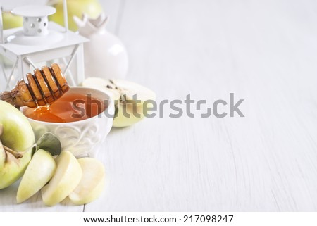 Apple and honey, traditional food of jewish New Year celebration, Rosh Hashana. Selective focus. Copyspace background. High key. - stock photo