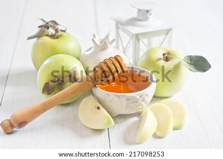 Apple and honey, traditional food of jewish New Year celebration, Rosh Hashana. Selective focus. High key. - stock photo