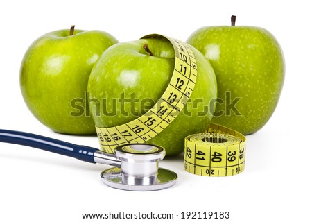 apple and measuring tape isolated on white background - stock photo