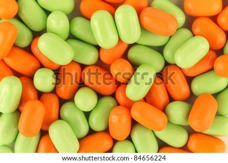 Apple and orange Tic Tacs - stock photo