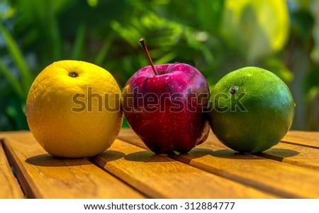 Apple and oranges - stock photo