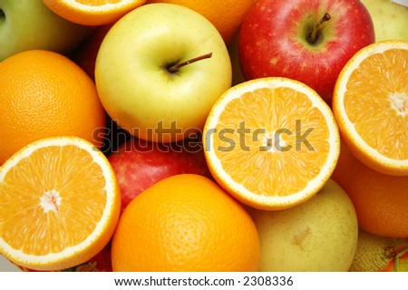 Apple and oranges at the market stand - stock photo