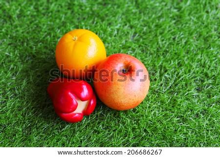 Apple, apples, oranges - stock photo