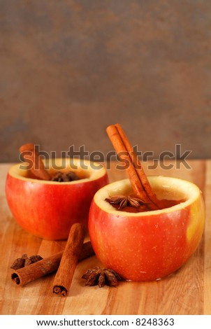 Apple cider in hollowed out apple with cinnamon and star anise - stock photo