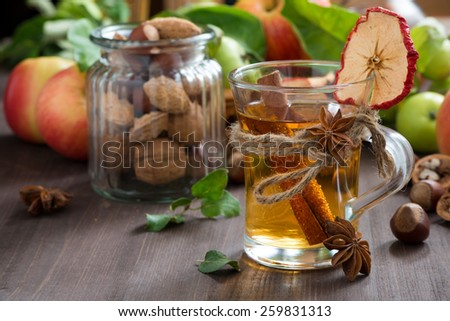 apple cider with spices in a glass cup, horizontal - stock photo