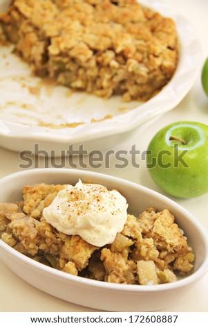 Apple Cobbler Crisp whipped cream cinnamon - stock photo