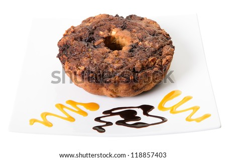 Apple coffee cake on a platter with swirls of chocolate and caramel, isolated on a white background - stock photo