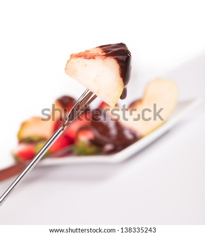 apple dipped in chocolate fondue - stock photo