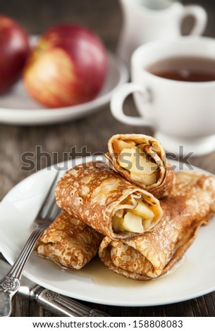 Apple-filled crepes - stock photo