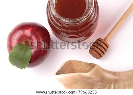 Apple, honey and Shofar on a white background - stock photo