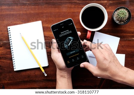 Apple iPhone 6 plus  activity Application Apple Watch try to connect apple watch. Comparing Watch and iPhone Statistics.CHIANG MAI,THAILAND - SEP  19,2015 - stock photo