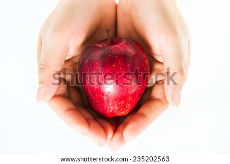 Apple is on hand with a white background. - stock photo