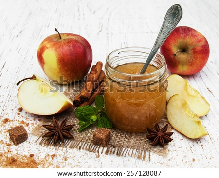 Apple jam and fresh apple on a wooden background - stock photo