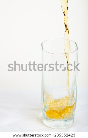 apple juice pouring into a glass - stock photo