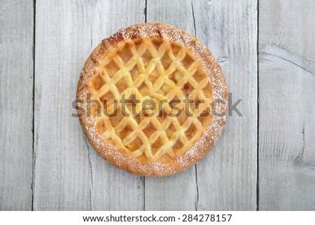 Apple Lattice Pie on wooden table surface - stock photo