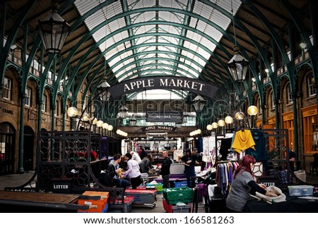 Apple market in Covent Garden in London.  London, United Kingdom - circa October, 2013: Apple market in Covent Garden in London. One of the most popular tourist attraction on Earth. - stock photo