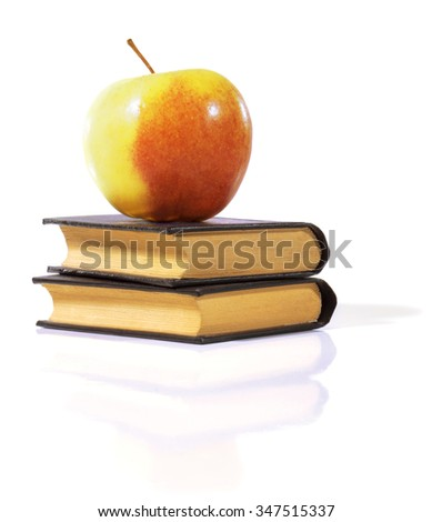 Apple on a books isolated on white - stock photo