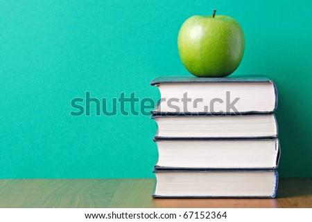 apple over books - stock photo