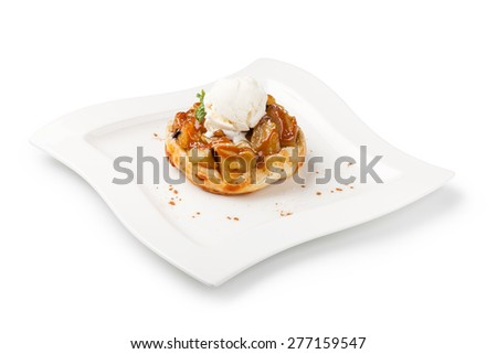 Apple pie on a plate - stock photo