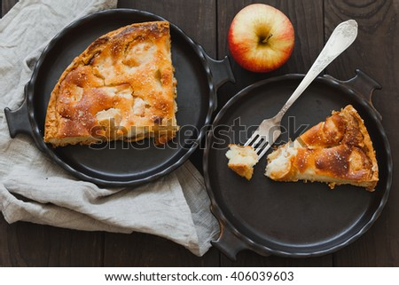 Apple pie on wooden background - stock photo