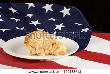 Apple pie.  Slice of apple pie with flag background - stock photo