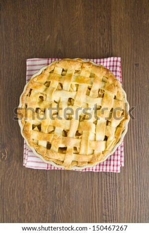 Apple pie with lattice top on red gingham - stock photo