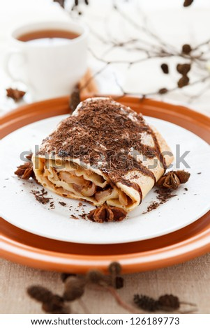 Apple pie with tea decorated grated chocolate. Delicious homemade dessert - stock photo