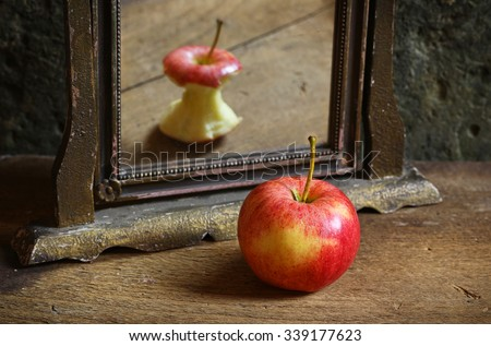 Apple reflecting in the mirror - stock photo