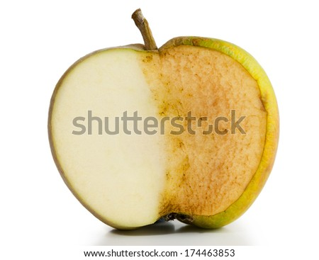 Apple sliced in half. Half fresh and half decayed on white background - stock photo