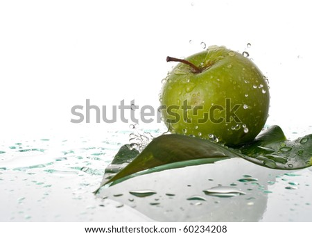 Apple Splashed with Fresh Water - stock photo