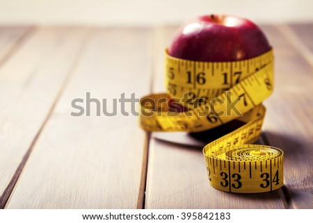 apple,sports, fitness, concept of weight loss, diet, nutrition - stock photo