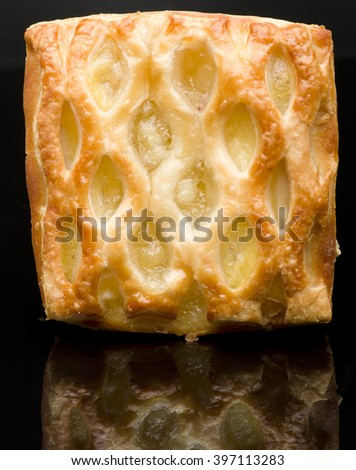 Apple strudel puff pastry isolated on a black background. - stock photo