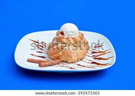 apple strudel with ice cream at blue background - stock photo