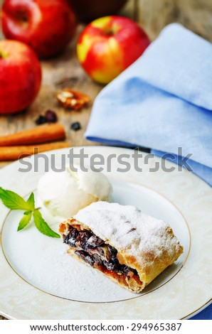 Apple strudel with nuts and raisins. toning. selective focus - stock photo