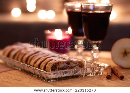 Apple strudel with sugar and mulled wine for Christmas  - stock photo