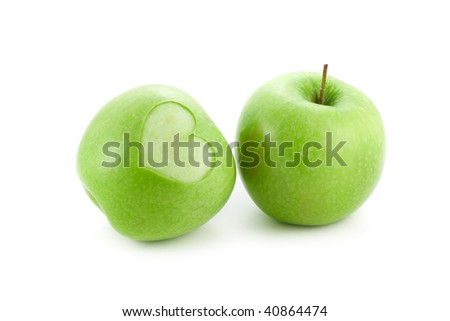 apple with a heart isolated on white - stock photo