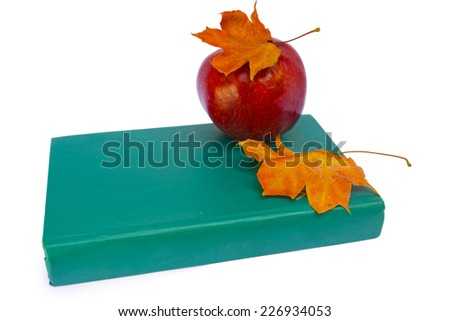 Apple with book and dry leaves  - stock photo