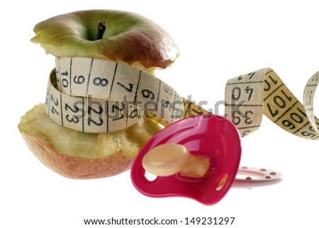 apple with measure tape and pacifier / Diet during pregnancy - stock photo