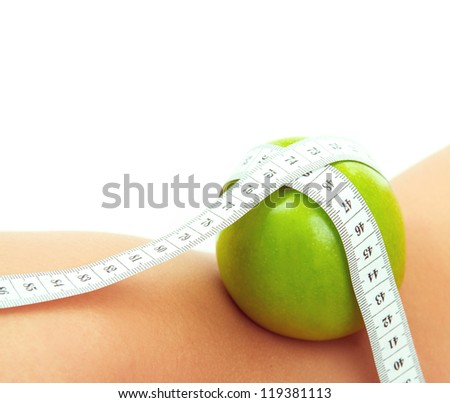 Apple with measure tape on womans body, isolated on white - stock photo
