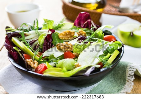 Apple with Rocket ,Radicchio and Walnut salad by vinaigrette - stock photo