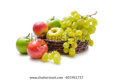 Apples and grapes. Various fresh ripe apples and grapes placed in a wicker basket and around isolated on a white background - stock photo