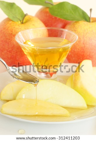 Apples and honey for Rosh Hashanah or Passover - stock photo
