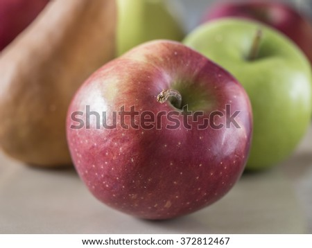 apples and pears on plate in close up - stock photo