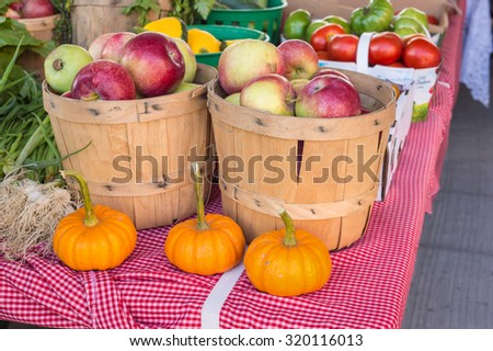 Apples and Pumpkins at the local food market - stock photo