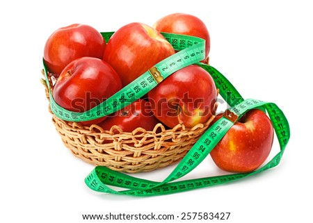 apples arranged in a basket and centimeter isolated on white background - stock photo
