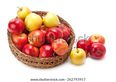 apples arranged in a basket isolated on white background - stock photo