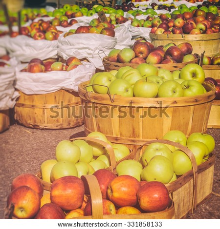 Apples at a Farmers Market. Baskets of apples, freshly picked in early autumn. - stock photo