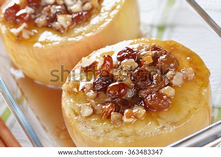 Apples baked with honey, nuts and raisins - stock photo